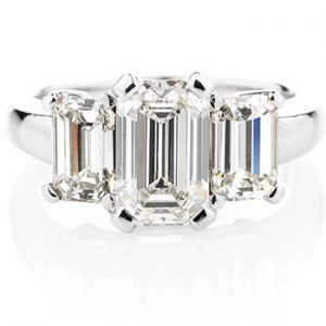 Platinum ring featuring three stunning emerald cut diamonds each set in a classic four claw setting.