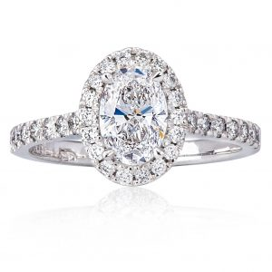 1ct oval diamond halo engagement ring with no bowtie and larger spread than a round diamond