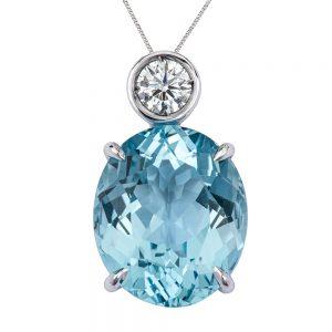 Oval Aquamarine and Swiss Set Diamond Pendant