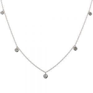 18 karat white gold trace style chain featuring five bezel set round diamond charms.