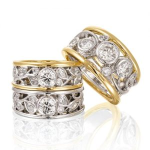18k yellow and white gold comprising round brilliant cut, pear shaped and marquise diamonds