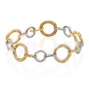 18 karat yellow and white gold circle-bar style bracelet.