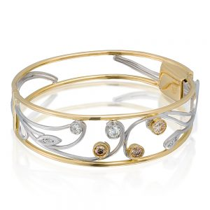 18 karat yellow and white gold cuff bangle, set withd round brilliant cut champagne and white diamonds in a swirl style