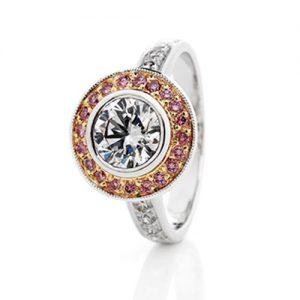 Charming pink and white diamond halo ring with 18 karat white gold