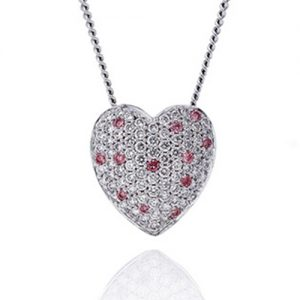 White and pink diamond pave set heart pendant