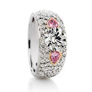 Brilliant pear cut pink diamonds in a pave ring