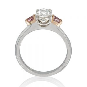 Pear-shaped diamonds are a unique choice for a large statement ring and layer with other jewelry.