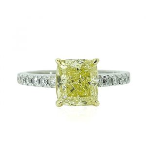 18 karat white gold, platinum and yellow gold claw and grain set yellow and white diamond engagement ring