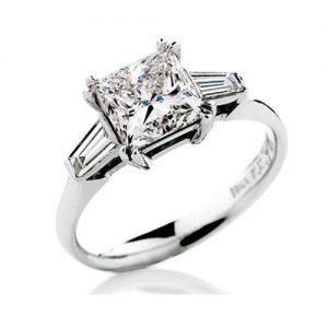 Princess cut diamond ring with bezel set tapered baguette cut diamonds