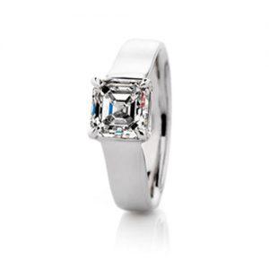 Sweep claw set asscher cut diamond ring set in an 18 karat white gold wide band