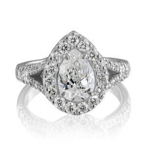 18 karat white gold and platinum cluster style top ring claw set with one pear shape diamond.