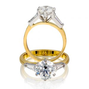 Round brilliant with a tapered baguettes engagement diamond top ring