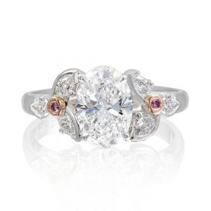 Luxurious Oval and Pear Cut Diamond Ring with Pink Diamond Detail