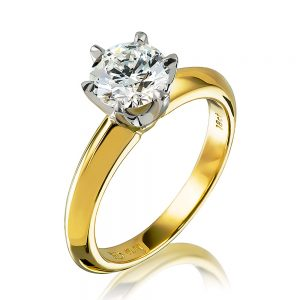 18 karat yellow gold and platinum ring with round brilliant cut diamond and knife edge band