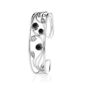 18 karat white gold black and white round brilliant cut diamond swirl styled cuff bangle.