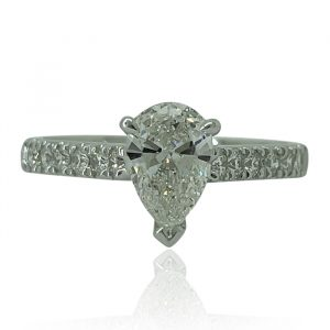 Pear shaped diamond engagement ring with shoulder claw set band