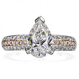 The modified brilliant-cut pear shaped diamond engagement ring, with white and pink diamond band