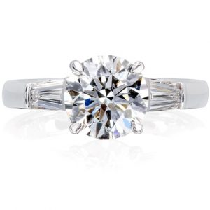Classic style solitaire diamond ring with tapered baguette shoulder