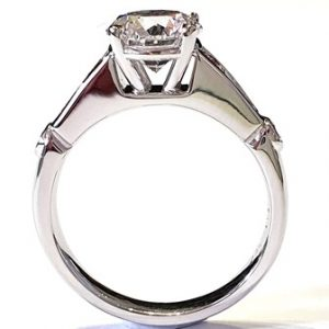 Classic baguette shaped and ideal-cut round diamond with 4 argyle pink diamonds
