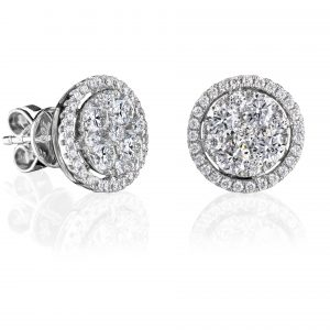 18 karat white gold claw and grain set halo style diamond earrings.
