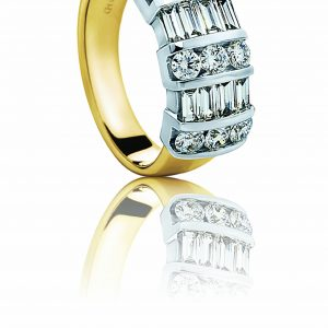 Yellow gold band with platinum baguette and round diamonds